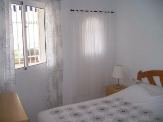 Master bedroom double bed and en-suite toilet and basin