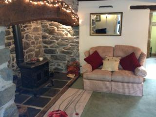 Lounge with inglenook fireplace and woodburning stove