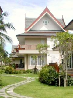 3 story beach villa view from tropical gardens