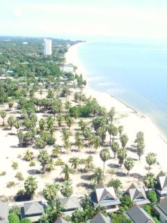 Beach view from above right in front of villa