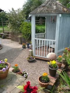 Secluded garden area. A perfect place to relax in the sun.