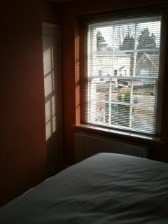 View of canal from main bedroom with king size bed (can also be arranged as two singles).