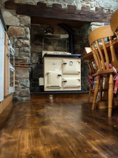 Kitchen.  Oil Rayburn gives back ground heating---great for slow roasting those joints of