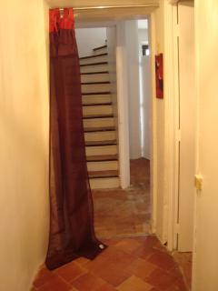 Stairs leading up to the other two bedrooms