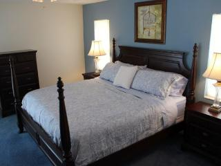Master bedroom with poster bed
