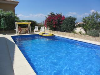 Private swimming pool with low chlorine water