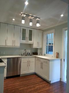 The kitchen is fully equipped with four stainless steel appliances.