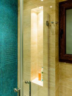 Turquoise tiled en-suite bathroom 1