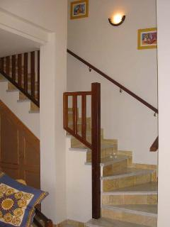 Marble stairs to bedroom, in cupboard under stairs is washing machine, ironing board & accessori