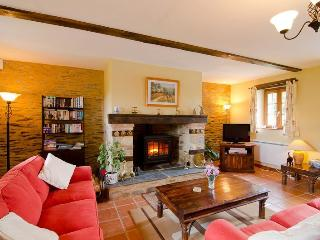 Downstairs lounge area with its welcoming log burner