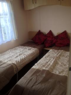 Twin bedroom rent this caravan out for you family holiday.