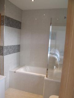 Family bathroom large bath with over bath shower