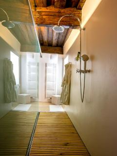take a long hot shower in the large walk-through shower cabin