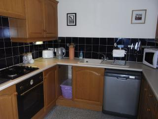 A well-equipped kitchen with dishwasher etc (separate laundry area with washing and drying machines)