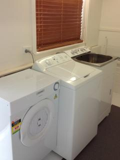 Guest's laundry with tub washing machine dryer and line