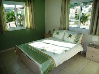 SPACIOUS MASTER BEDROOM WIH DOUBLE SIZE BED, AIR CONDITIONING AND LOVELY HILLSIDE VIEWS