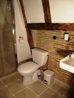 Ensuite shower room for the twin bedroom with expose chimney breast & oak beams.