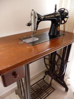 The old sewing machine, a beautiful masterpiece of a previous century.