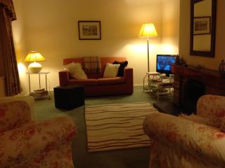 The spacious living room with open fire, TV, DVD player, CD, books and games for an evening in...