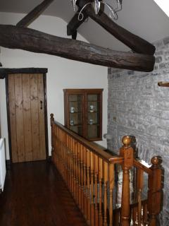 Stunning oak beams and exposed limestone walls.
