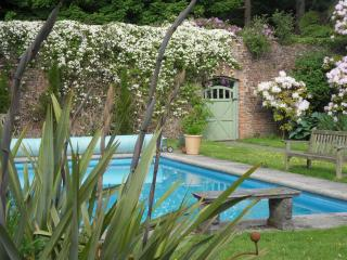 private swimming pool within walled garden usually heated from May to October.