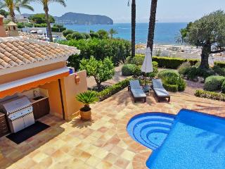 View from the bedroom terrace overlooking the amazing blue sea and swimming pool.