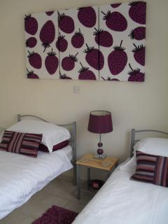 Bedroom 2.With two single beds and plenty of space for all your clothes.