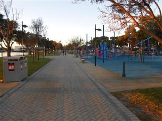 Main boardwalk across from cafe strip located short 200m walk along foreshore from townhouse