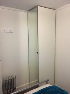 Floor to Ceiling mirrored wardrobes with integral hangers