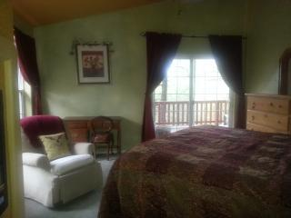 Master bedroom on second floor has walk out to balcony and hot tub