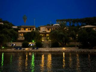 The Villa's view at night from the sea
