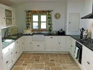 Painted pine kitchen with granite worktops.