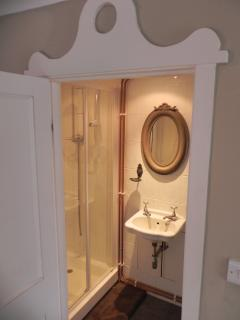 The cute shower room is downstairs off of the kitchen
