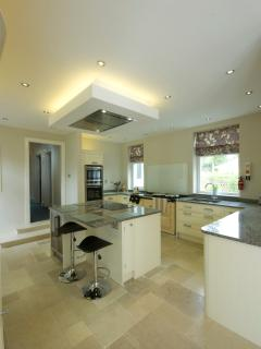 Open plan kitchen with 4 oven AGA,induction hob, electric oven, microwave and wine fridge