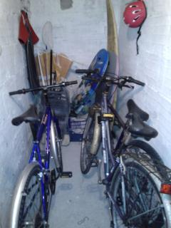 cellar with bikes and beach tools