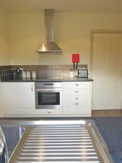 Crisp clean kitchen with underfloor heating