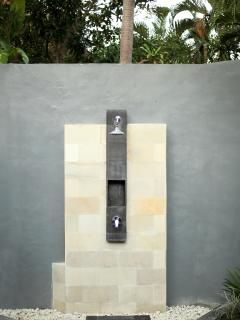 Outdoor shower close to pool