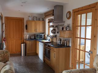 The well equipped, compact kitchen, with Neff induction hob, cooker, dishwasher and microwave