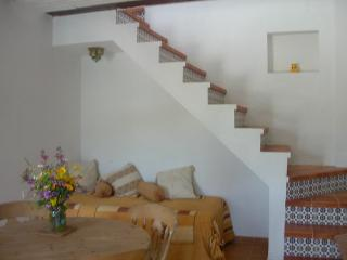 Seating area of lounge/diner and stairs up to bedrooms