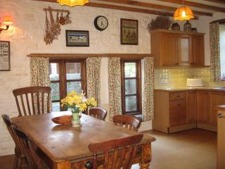 Kitchen is generously equipped with electric cooker, gas hob, fridge, freezer, microwave & wash