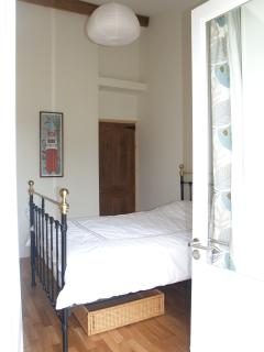 The master bedroom with doors leading directly onto the garden