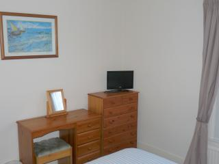 Double bedroom with built in wardrobe and tv