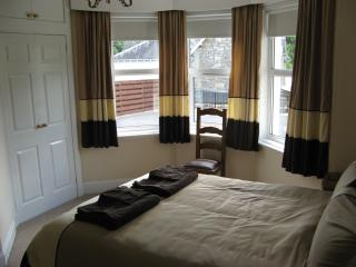 Downstairs bedroom with fitted wardrobe, ample drawer space and en suite shower room