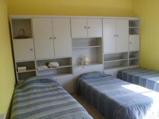 yellow room with kitchenette..