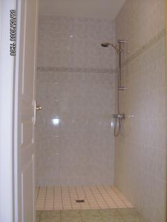 In addition to the large bathroom there is a spacious shower room.