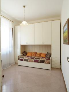 good sized twin bedroom with good wardrobe space, showing one single bed second is pulled out