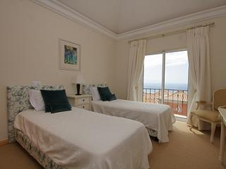 GUEST BEDROOM , SEA VIEW AND EXTENDING ONTO BALCONY