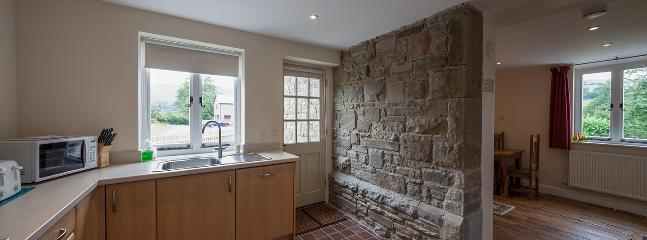 Original wall divides kitchen/diner