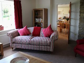 The sitting room adjoins the kitchen