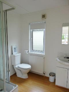All bedrooms ensuite two with showers one with bath and shower